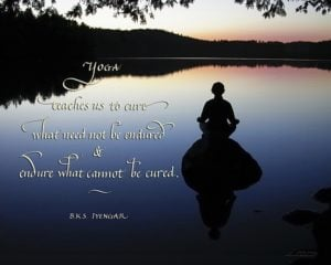 yoga quote in calligraphy on beautiful background with meditating woman