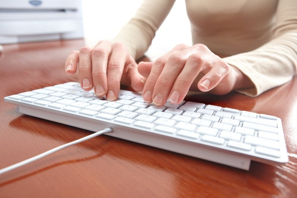 hands typing on a keyboard to order online calligraphy
