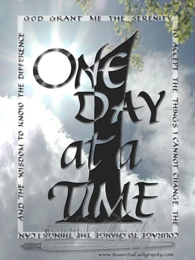 One Day At A Time written in a calligraphy design